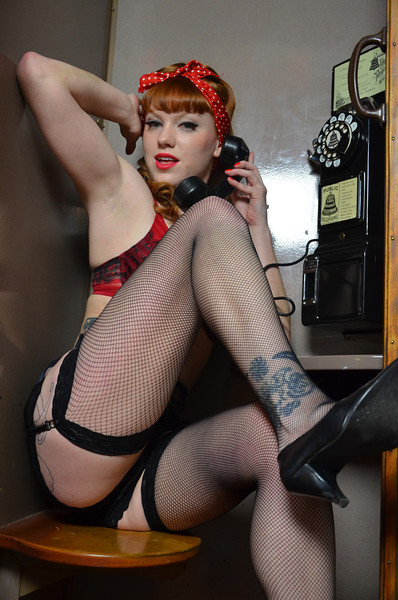Pinup Model Miss Merlot in a Phone Booth